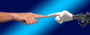 Human index finger touching robot index finger