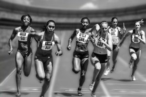 women in relay race, passing batons